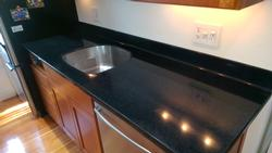 Remove Brazillian Brown Quartz and Replace with Coved Splash Deep Quartz Dupont Corian